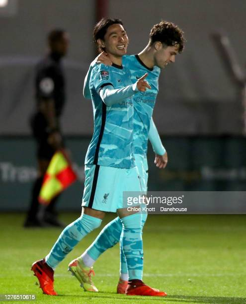 Takumi Minamino of Liverpool FC celebrates scoring his teams fifth goal during the Caraboa Cup Third Round match between Lincoln City FC and...