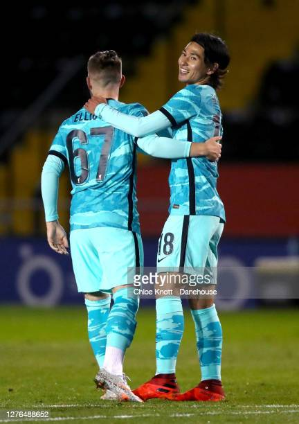 Takumi Minamino of Liverpool FC celebrates scoring his teams second goal during the Caraboa Cup Third Round match between Lincoln City FC and...