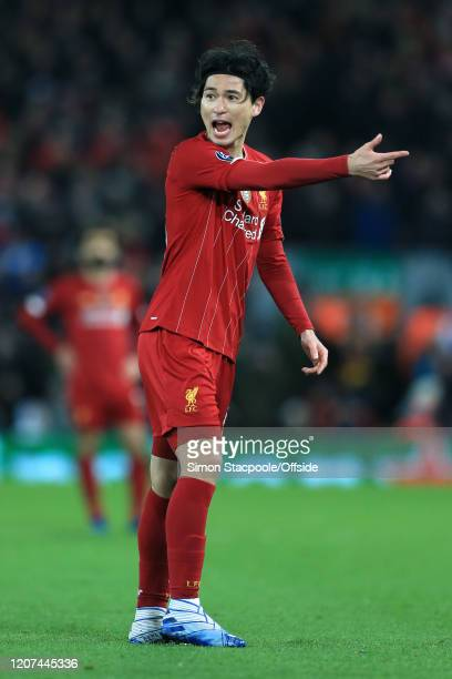 Takumi Minamino of Liverpool gestures during the UEFA Champions League round of 16 second leg match between Liverpool FC and Atletico Madrid at...