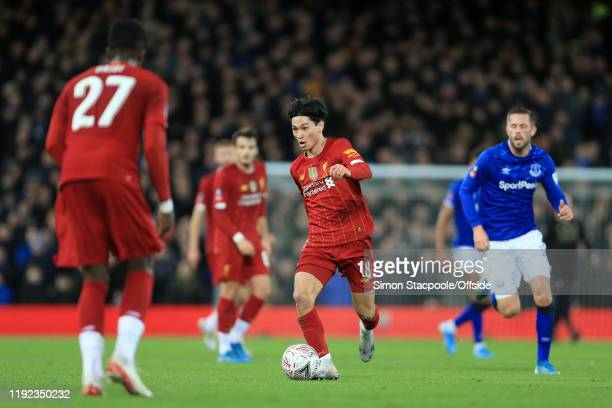 Takumi Minamino of Liverpool in action during the FA Cup Third Round match between Liverpool and Everton at Anfield on January 5, 2020 in Liverpool,...