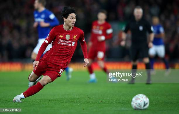 Takumi Minamino of Liverpool in action during the FA Cup Third Round match between Liverpool FC and Everton FC at Anfield on January 05 2020 in...