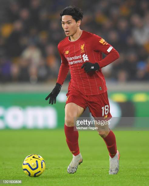 Takumi Minamino of Liverpool in action during the Premier League match between Wolverhampton Wanderers and Liverpool FC at Molineux on January 23,...