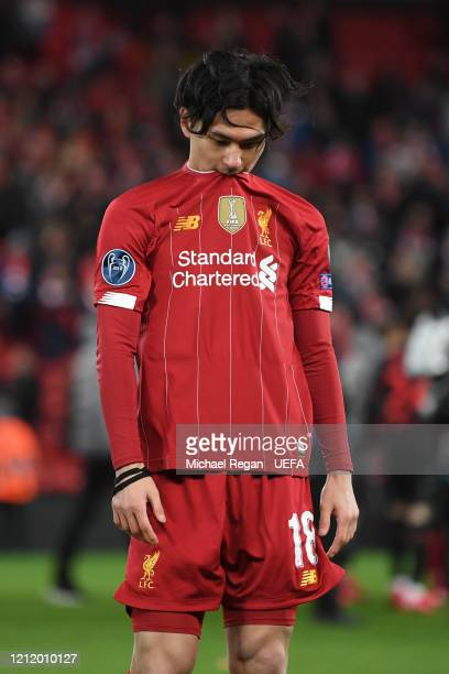 Takumi Minamino of Liverpool leaves the pitch dejected after the UEFA Champions League round of 16 second leg match between Liverpool FC and Atletico...