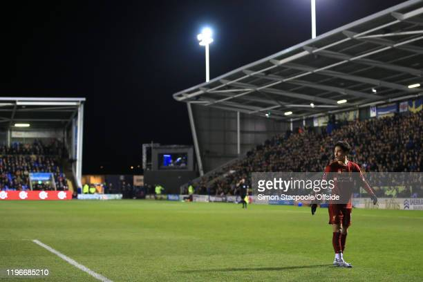 Takumi Minamino of Liverpool looks back during the FA Cup Fourth Round match between Shrewsbury Town and Liverpool FC at New Meadow on January 26...