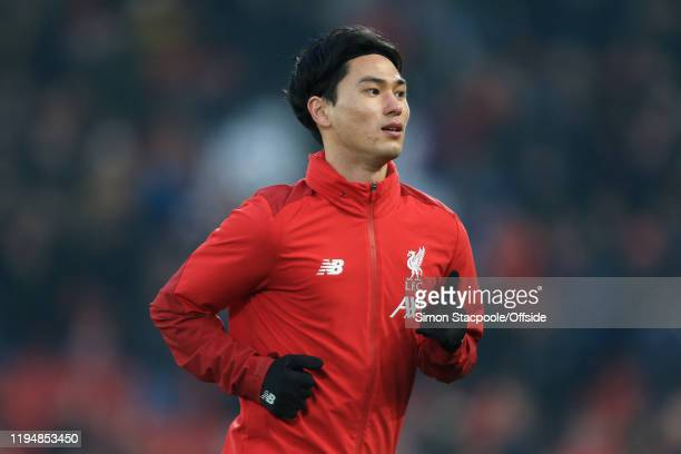Takumi Minamino of Liverpool looks on before the Premier League match between Liverpool FC and Manchester United at Anfield on January 19 2020 in...