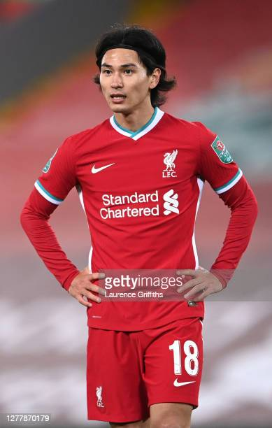 Takumi Minamino of Liverpool looks on during the Carabao Cup fourth round match between Liverpool and Arsenal at Anfield on October 01, 2020 in...