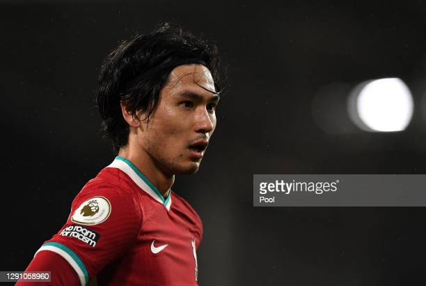 Takumi Minamino of Liverpool looks on during the Premier League match between Fulham and Liverpool at Craven Cottage on December 13, 2020 in London,...