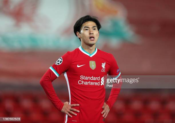Takumi Minamino of Liverpool looks on during the UEFA Champions League Group D stage match between Liverpool FC and FC Midtjylland at Anfield on...