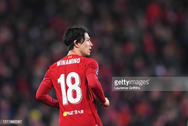Takumi Minamino of Liverpool looks on during the UEFA Champions League round of 16 second leg match between Liverpool FC and Atletico Madrid at...