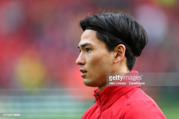 Takumi Minamino of Liverpool looks on during the warm up prior to the Premier League match between Liverpool FC and AFC Bournemouth at Anfield on...