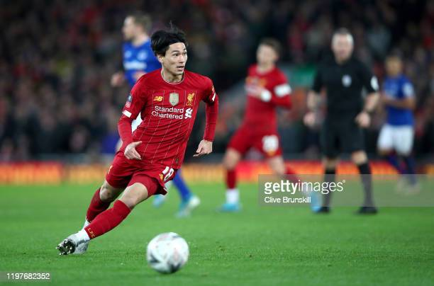 Takumi Minamino of Liverpool runs with the ball during the FA Cup Third Round match between Liverpool and Everton at Anfield on January 05 2020 in...