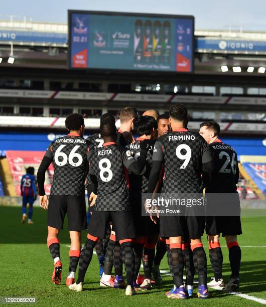 Takumi Minamino of Liverpool scores the first goal and celebrates during the Premier League match between Crystal Palace and Liverpool at Selhurst...