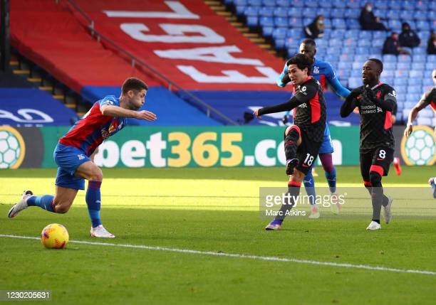Takumi Minamino of Liverpool scores the opening goal during the Premier League match between Crystal Palace and Liverpool at Selhurst Park on...