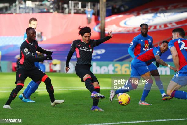 Takumi Minamino of Liverpool scores their sides first goal during the Premier League match between Crystal Palace and Liverpool at Selhurst Park on...