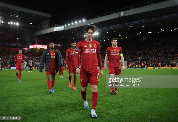Takumi Minamino of Liverpool walks off dejected after the UEFA Champions League round of 16 second leg match between Liverpool FC and Atletico Madrid...