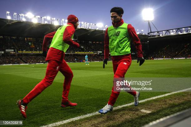 Takumi Minamino of Liverpool warms up down the sidelines at Vicarage Road during the Premier League match between Watford FC and Liverpool FC at...