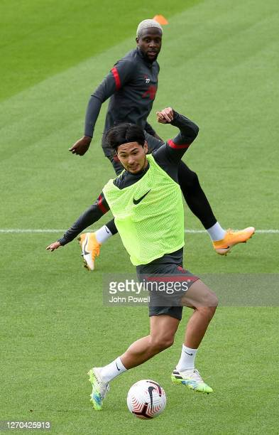 Takumi Minamino of Liverpool with Divock Origi of Liverpool in action during a training session at Melwood Training Ground on September 03 2020 in...