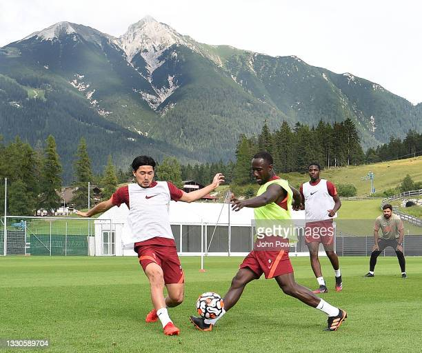 Takumi Minamino of Liverpool with Naby Keita of Liverpool during a training session on July 25, 2021 in UNSPECIFIED, Austria.
