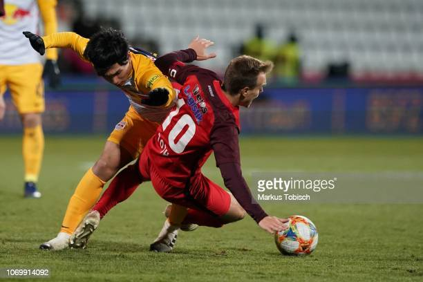 Takumi Minamino of RB Salzburg and Daniel Toth of Admira during the tipico Bundesliga match between FC Admira Wacker and RB Salzburg at BFSZArena on...
