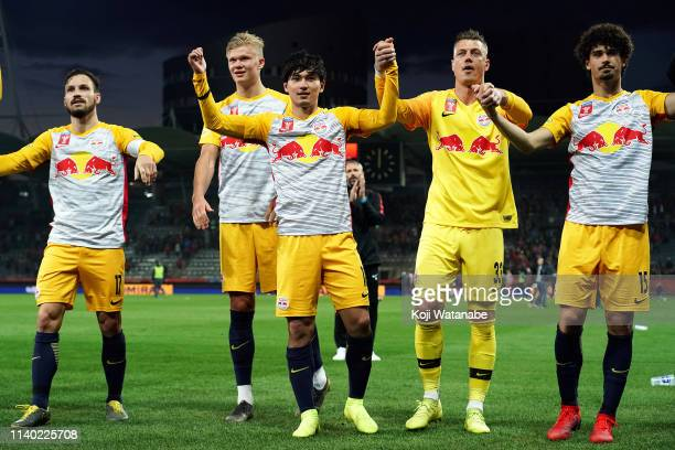 Takumi Minamino of RB Salzburg celebrate after winning of RB Salzburg during the OFB Cup match between Grazer AK and Red Bull Salzburg at Merkur...
