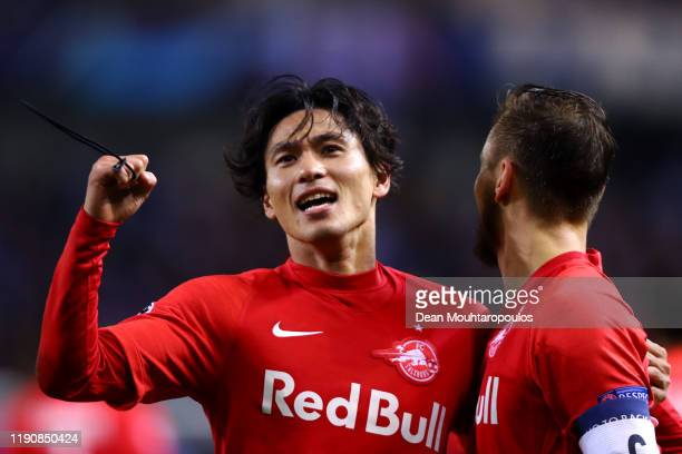 Takumi Minamino of RB Salzburg celebrates scoring his teams second goal of the game with team mate Andreas Ulmer during the UEFA Champions League...