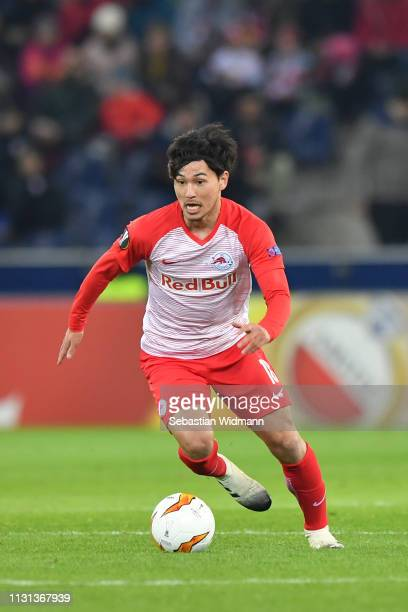 Takumi Minamino of RB Salzburg runs with the ball during the UEFA Europa League Round of 32 Second Leg match between RB Salzburg and Club Brugge at...
