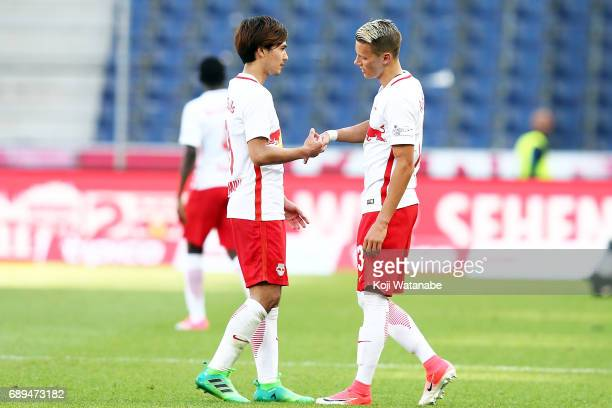Takumi Minamino of Red Bull Salzburg celebrate a win during the Austrian Bundesliga match between Red Bull Salzburg and Cashpoint SCR Altach at Red...