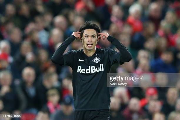 Takumi Minamino of Red Bull Salzburg celebrates after he scores his sides second goal during the UEFA Champions League group E match between...