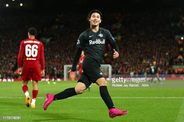 Takumi Minamino of Red Bull Salzburg celebrates after scoring a goal to make it 3-2 during the UEFA Champions League group E match between Liverpool...