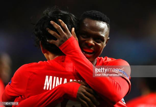 Takumi Minamino of Red Bull Salzburg celebrates with teammate Patson Daka after scoring his team's second goal during the UEFA Champions League group...
