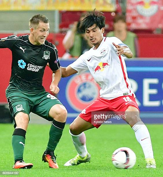 Takumi Minamino of Red Bull Salzburg is seen in action during the first half of a Europa League match against FC Krasnodar in Salzburg Austria on...
