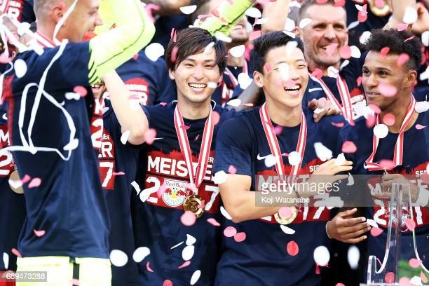 Takumi Minamino of Red Bull Salzburg players celebrate with the gold medal during the Austrian Bundesliga match between Red Bull Salzburg and...