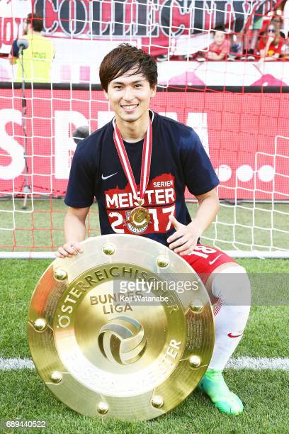Takumi Minamino of Red Bull Salzburg players celebrate with the trophy during the Austrian Bundesliga match between Red Bull Salzburg and Cashpoint...