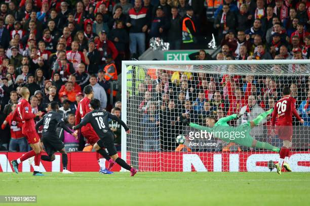 Takumi Minamino of Red Bull Salzburg scores his sides second goal during the UEFA Champions League group E match between Liverpool FC and RB Salzburg...