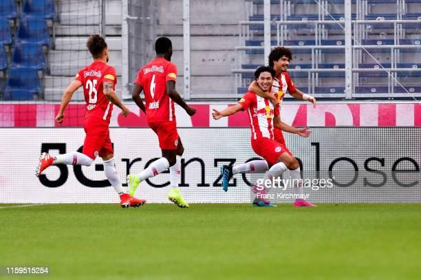 Takumi Minamino of Salzburg celebrate with his team the goal at the tipico Bundesliga match between FC Red Bull Salzburg and SV Mattersburg at Red...