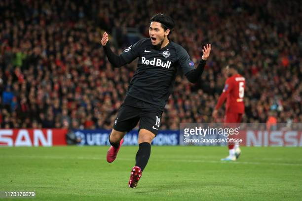Takumi Minamino of Salzburg celebrates after scoring their 2nd goal during the UEFA Champions League group E match between Liverpool FC and RB...