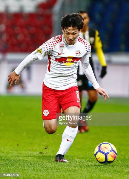 Takumi Minamino of Salzburg dribbles the ball during the team's 00 draw against LASK in Austrian Bundesliga football at Red Bull Arena in Salzburg on...