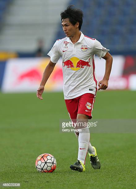 Takumi Minamino of Salzburg runs with the ball during the tipico Bundesliga match between RB Salzburg and Austria Wien at Red Bull Arena on August 23...