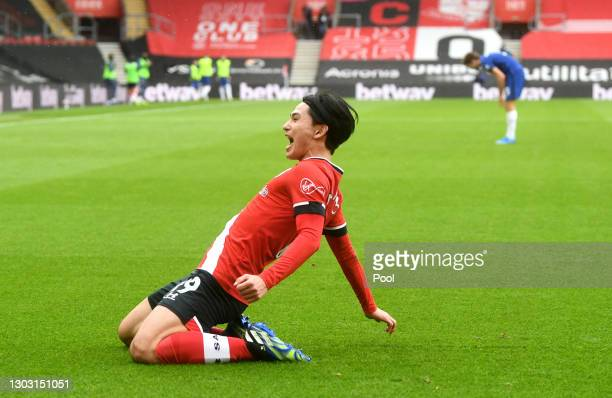 Takumi Minamino of Southampton celebrates after scoring his team's first goal during the Premier League match between Southampton and Chelsea at St...
