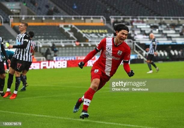 Takumi Minamino of Southampton celebrates after scoring their first goal during the Premier League match between Newcastle United and Southampton at...