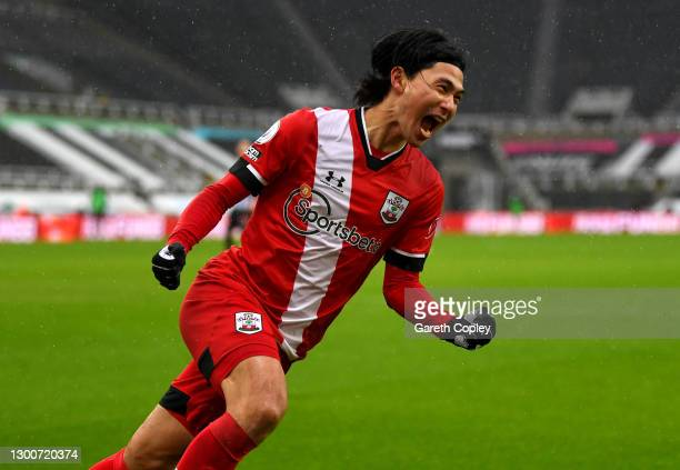Takumi Minamino of Southampton celebrates after scoring their side's first goal during the Premier League match between Newcastle United and...