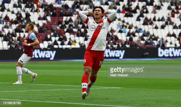 Takumi Minamino of Southampton reacts after shooting wide during the Premier League match between West Ham United and Southampton at London Stadium...