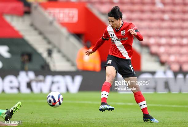 Takumi Minamino of Southampton scores his team's first goal during the Premier League match between Southampton and Chelsea at St Mary's Stadium on...