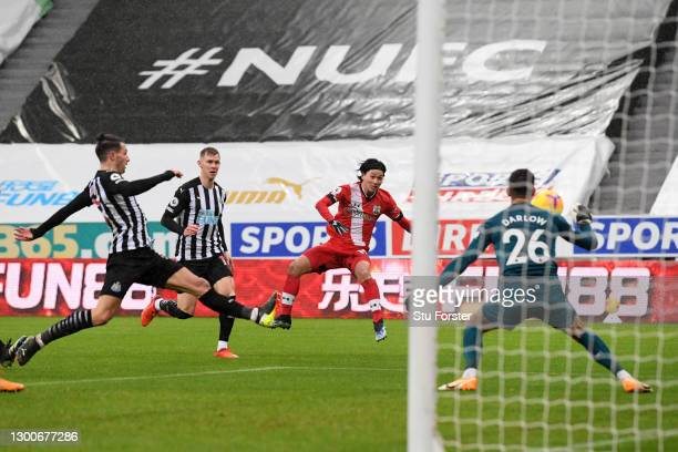 Takumi Minamino of Southampton scores their side's first goal during the Premier League match between Newcastle United and Southampton at St. James...