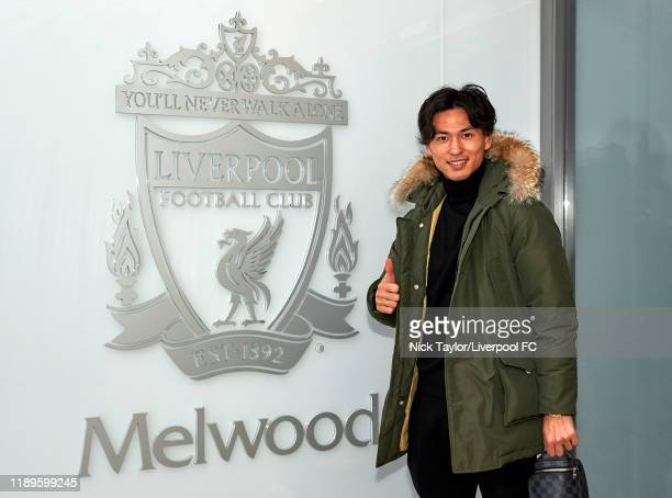 Takumi Minamino signs for Liverpool Football Club on December 18, 2019 in Liverpool, England.