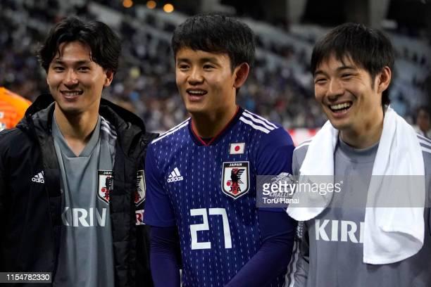 Takumi Minamino, Takefusa Kubo and Shoya Nakajima of Japan smile after defeating El Salvador during the international friendly match between Japan...