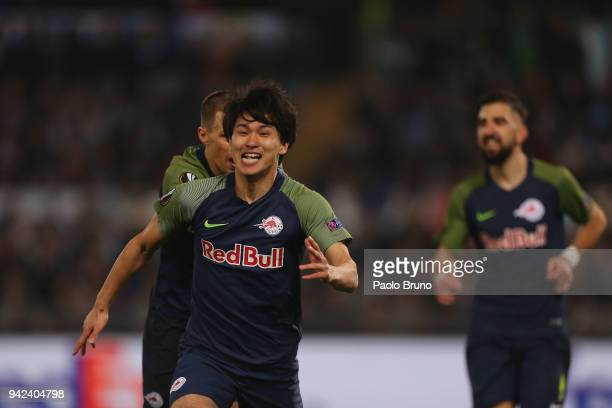 Takumi Minamino with his teammate of RB Salzburg celebrates after scoring the team's second goal during the UEFA Europa League quarter final leg one...