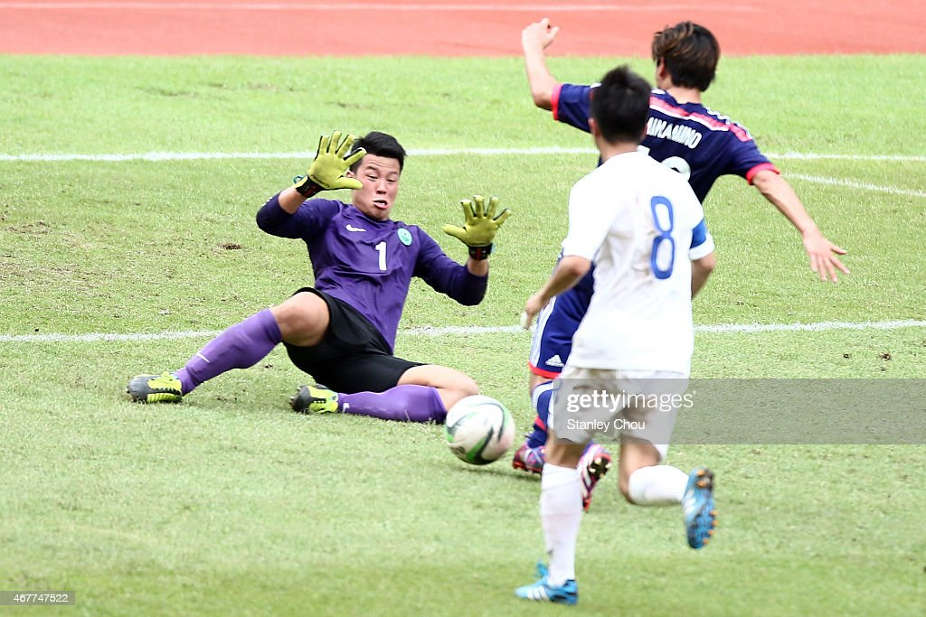 Takumi Minamino#13 of Japan scores his team's seventh goal past Ho Man Fai #1 of Macau during the AFC U23 Championship Qualifier Group I match between Japan and Macau at Shah Alam Stadium on March 27, 2015 in Shah Alam, Malaysia.