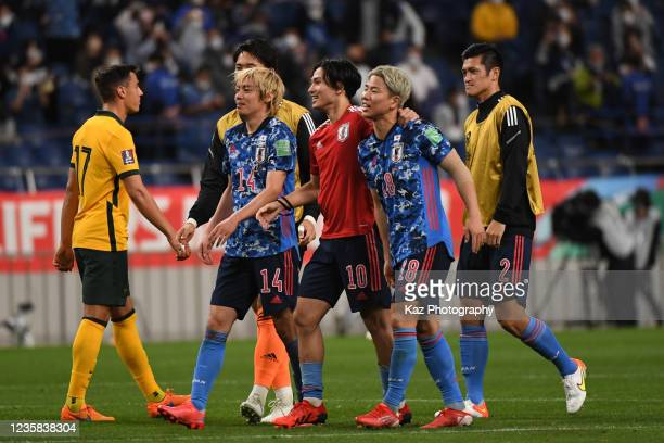 Takumi Minamino,Takuma Asano and Junya Ito of Japan celebrate the win during the FIFA World Cup Asian qualifier final round Group B match between...