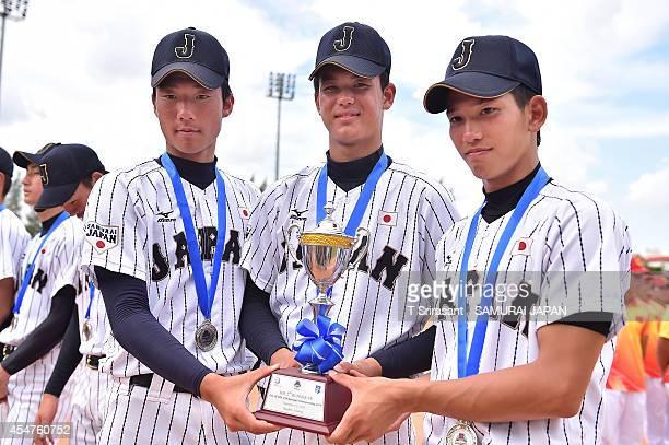 Takumi Minemoto Kona Takahashi and Ryoya Kurihara of Japan pose with a trophy during the Asian 18U Baseball Championship final game between Japan and...